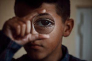 Child with lens. Photo by Gëzim Fazliu