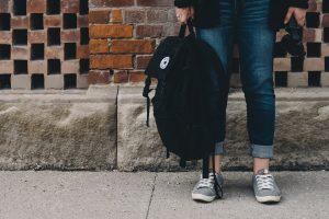 Image of person holding backpack Credit: Scott Webb on Unsplash