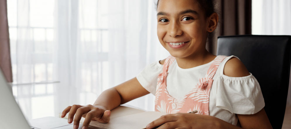 child working on computer